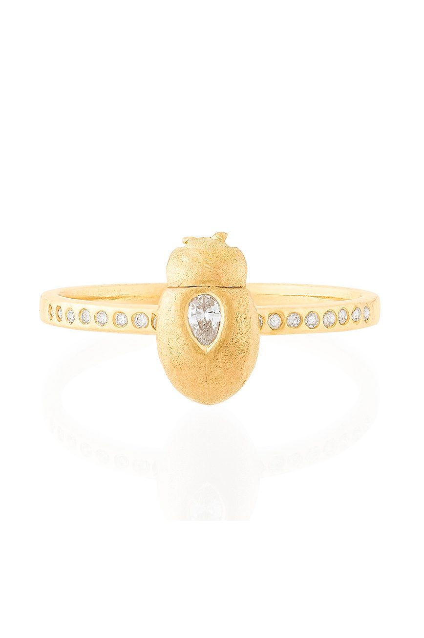 celine daoust from the earth diamond scarab ring featuring one pear shaped diamond on scarab and pave diamonds on the band