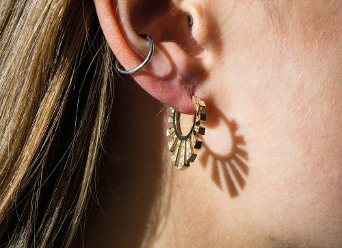 celine daoust aztec protection and believes sun hoop earring