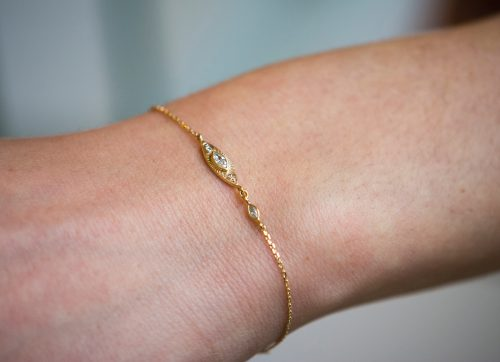yellow gold protection and believes sun eye chain bracelet