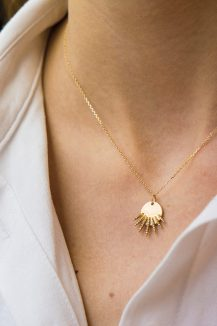 yellow gold white diamonds sunbeams medal necklace celine daoust